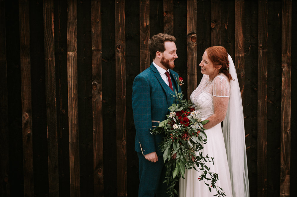 Bride Bridal Jenny Packham Beaded Dress Gown Three Piece Suit Groom Burgundy Tie Foliage Cascading Bouquet Berries Hazel Gap Wedding Maree Frances Photography