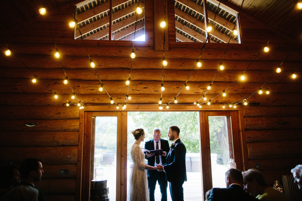 Festoon Lights Ceremony Hidden River Cabins Wedding Dan Hough Photo