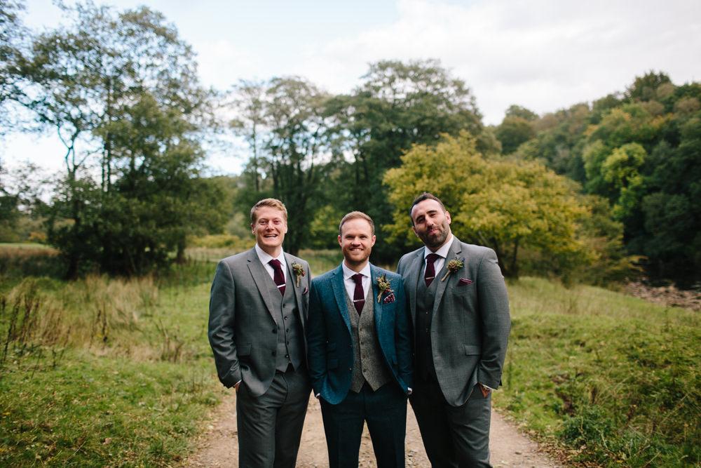Groom Groomsmen Blue Tweed Suit Red Tie Hidden River Cabins Wedding Dan Hough Photo