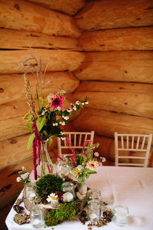 Table Flowers Decor Fern Dahlia Red Trailing Amaranthus Centrepiece Decor Moss Log Hidden River Cabins Wedding Dan Hough Photo