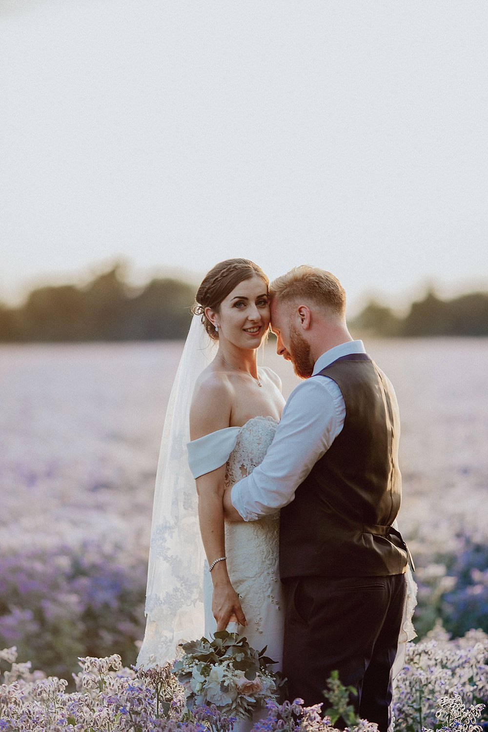 Relaxed & Fun Summer Farm Wedding with Portraits in the Lilac Fields