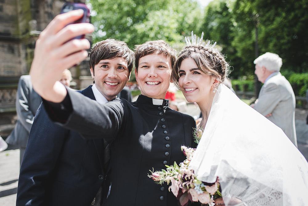 Bride Bridal Rue de Seine Dress Gown 70s Boho Sleeves Headdress Crown Morning Suit Groom Vicar Selfie Langar Hall Wedding Robert Leons Photography