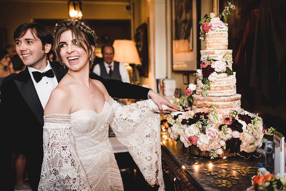 Bride Bridal Rue de Seine Dress Gown 70s Boho Sleeves Headdress Crown Dinner Bow Tie Suit Groom Langar Hall Wedding Robert Leons Photography