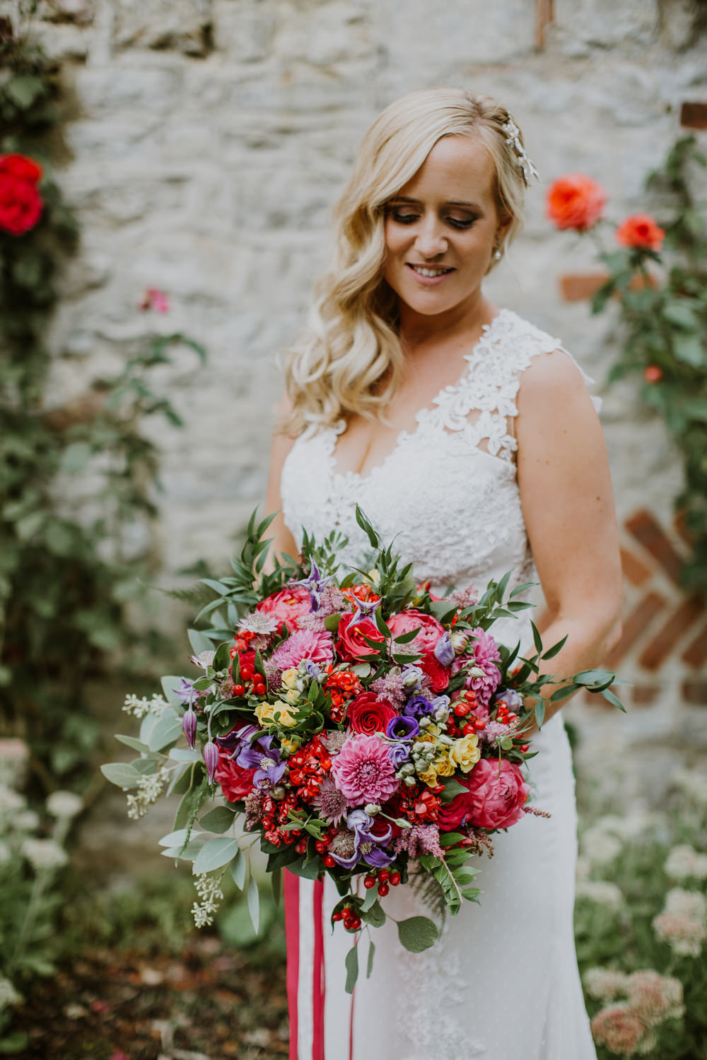Bouquet Flowers Bride Bridal Pink Red Purple Greenery Foliage Peony Rose Clematis Ribbons Notley Abbey Wedding Alexandra Jane Photography