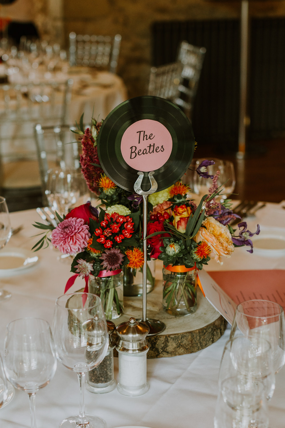 Music Records Vinyl Table Name Centrepiece Log Table Decor Flowers Notley Abbey Wedding Alexandra Jane Photography