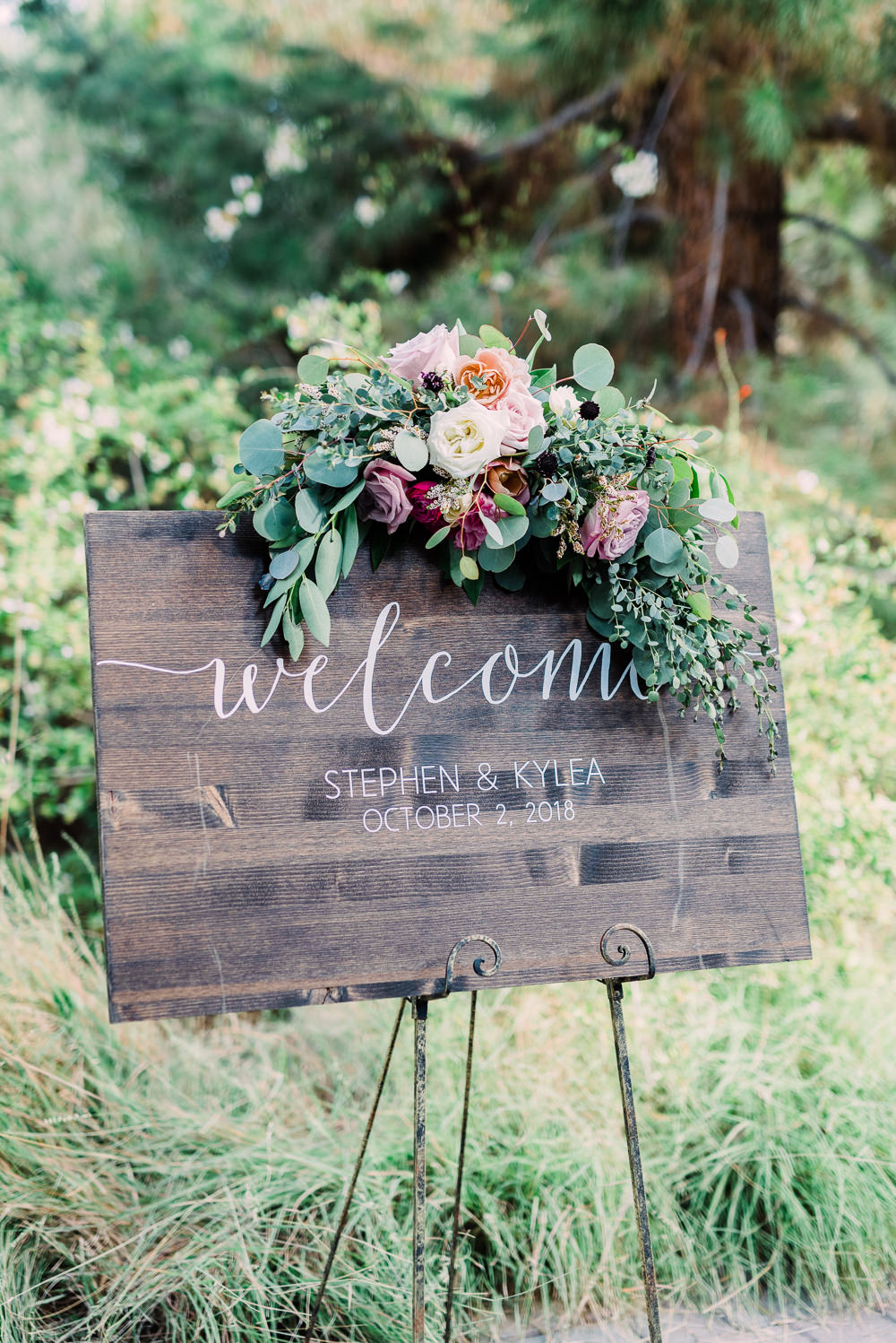 Wooden Welcome Sign Flowers Calligraphy Easel Romantic Soft Elopement Wedding Las Vegas Kristen Joy Photography