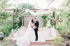 Outdoor Ceremony Wooden Backdrop Arch Drapes Fabric Pink Flowers Romantic Soft Elopement Wedding Las Vegas Kristen Joy Photography