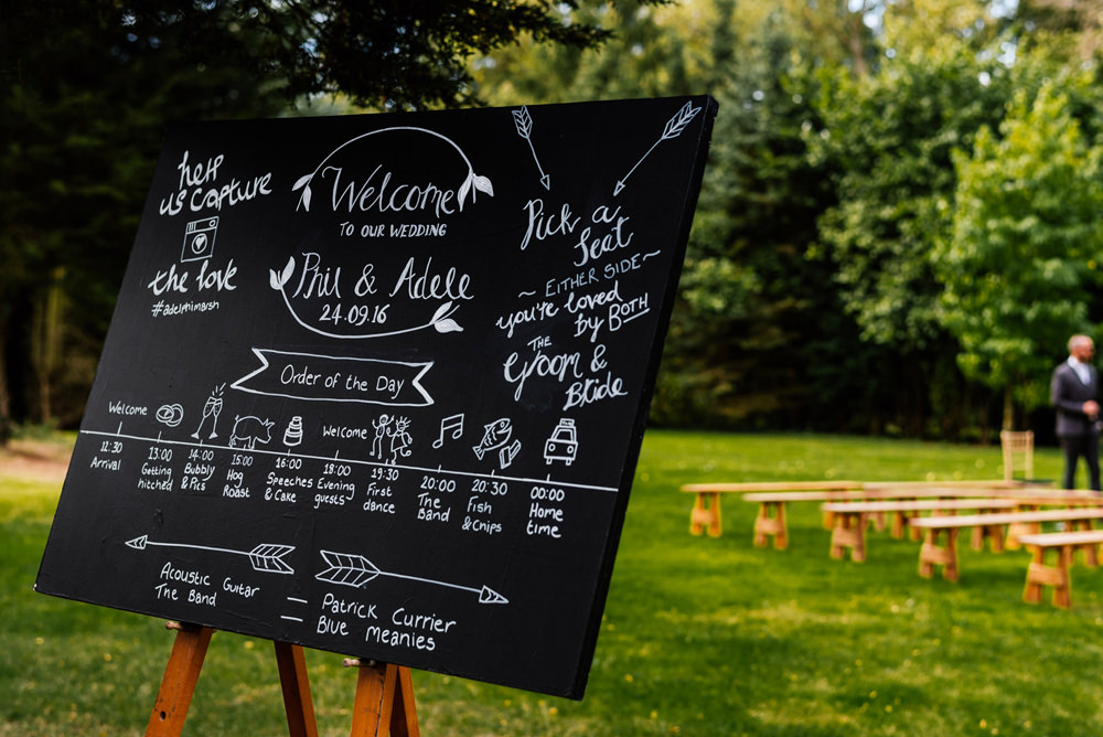 Order of the Day Blackboard Chalk Board Easel Outdoor Ceremony Secret Garden Wymington Wedding Aaron Collett Photography