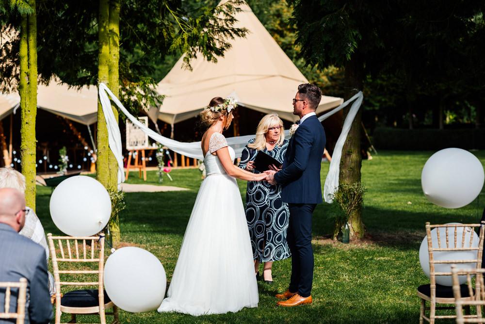 Bride Bridal Cap Sleeve Sweetheart Neckline Oversized Flower Crown Three Piece Waistcoat Groom Outdoor Ceremony Secret Garden Wymington Wedding Aaron Collett Photography
