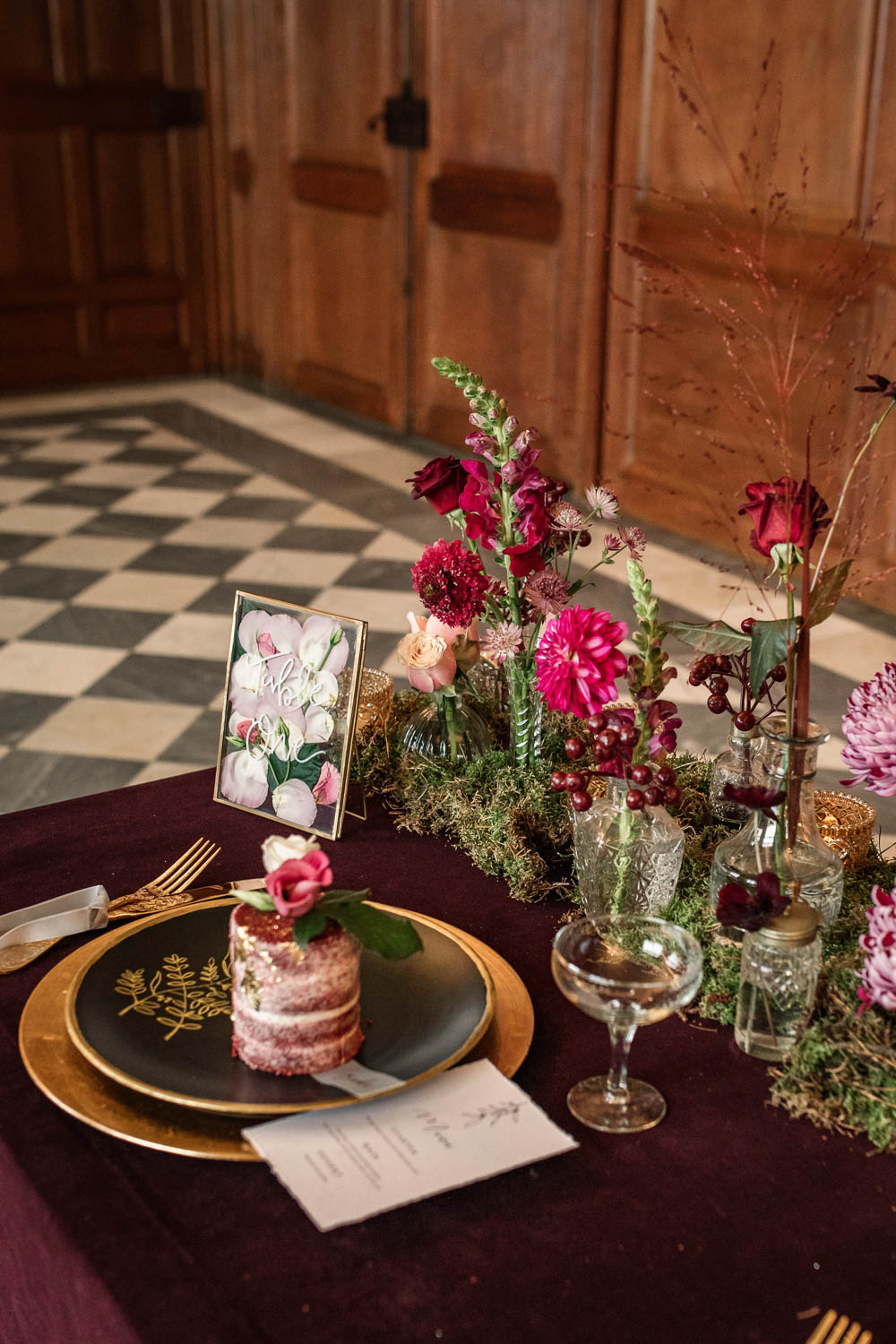 Table Tablescape Decor Red Velvet Cloth Flowers Pink Bottles Moss Gold Candles Plates Winter Luxe Wedding Ideas Becky Harley Photography