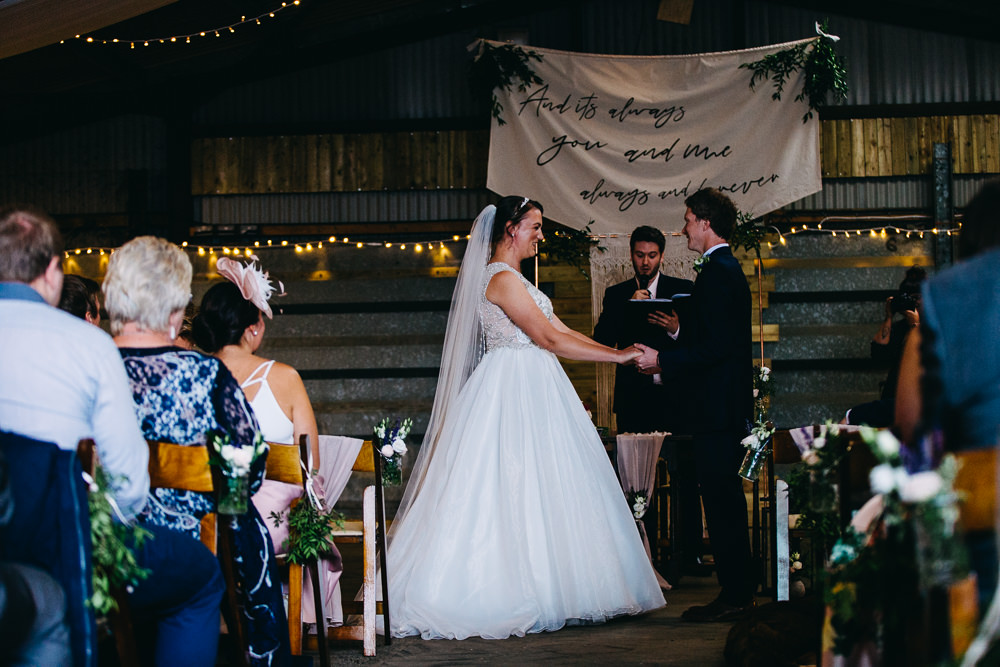 Ceremony Aisle Backdrop Barn Bohemian Macrame Banner Fabric Sign Fairy Lights Greenery Quote Bawdon Lodge Farm Wedding Hannah Hall Photography