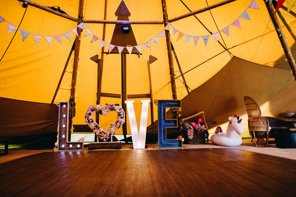 LOVE Letter Lights Bunting Tipi Bawdon Lodge Farm Wedding Hannah Hall Photography