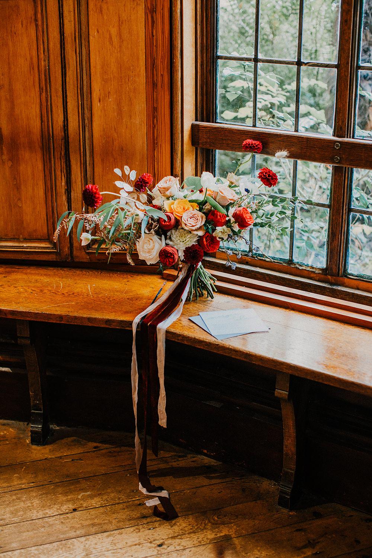 Bride Bridal Bouquet Flowers Red Rose Greenery Foliage Dahlia Ribbon Bohemian Music Folk Wedding Ideas Gail Secker Photography