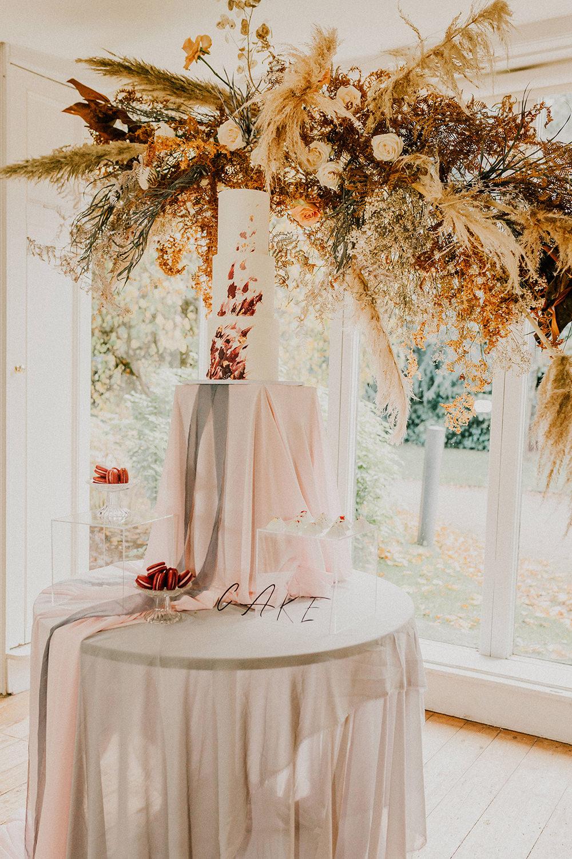 Cake Table Grasses Flowers Backdrop Installation Suspended Pampass Grass Sign Bohemian Music Folk Wedding Ideas Gail Secker Photography