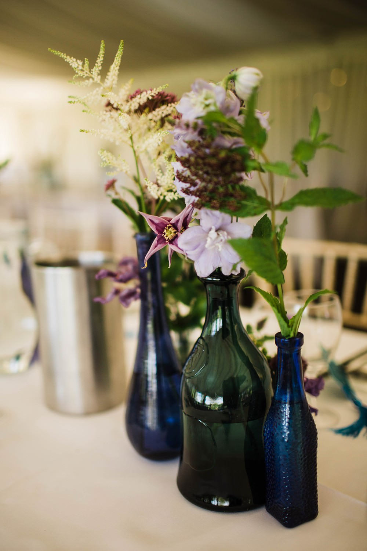 Bottles Flowers Blue Purple Cherwell Boathouse Wedding Claudia Rose Carter Photography