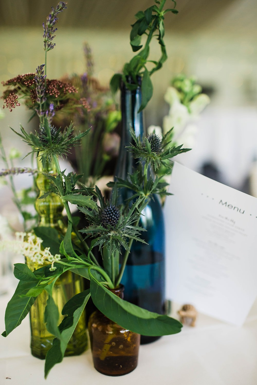 Bottles Flowers Wild Table Decor Centrepiece Cherwell Boathouse Wedding Claudia Rose Carter Photography