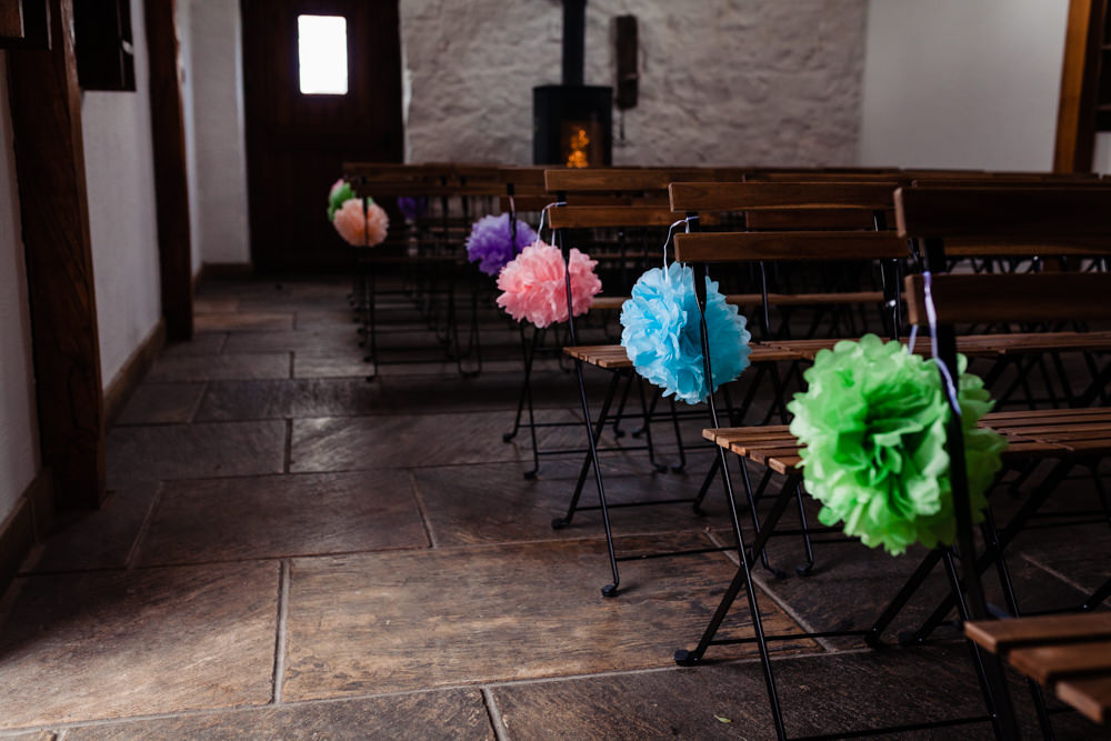 Pom Poms Aisle Chairs Ceremony Pew End Colourful Festival Party Wedding Emma and Rich Photography