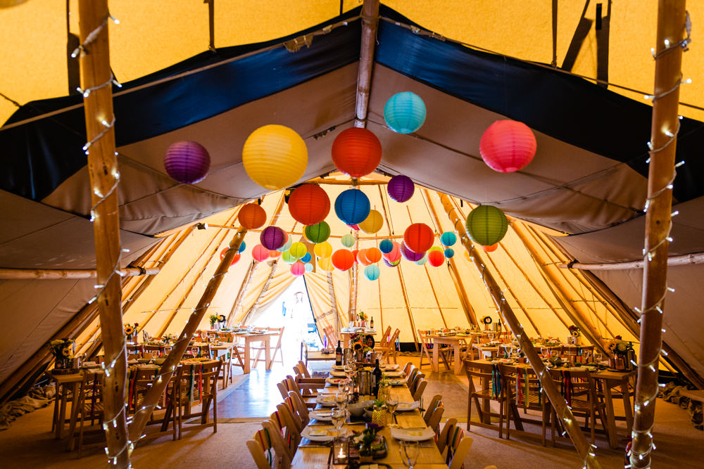 Tipi Lanterns Decor Rustic Tables Rainbow Decor Colourful Festival Party Wedding Emma and Rich Photography