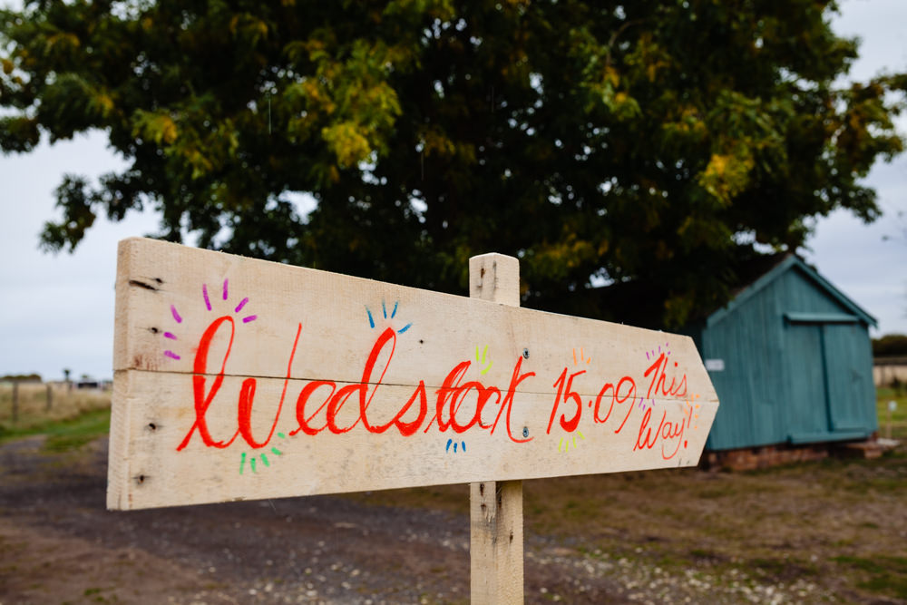 Wooden Rustic Sign Post Signage Colourful Festival Party Wedding Emma and Rich Photography