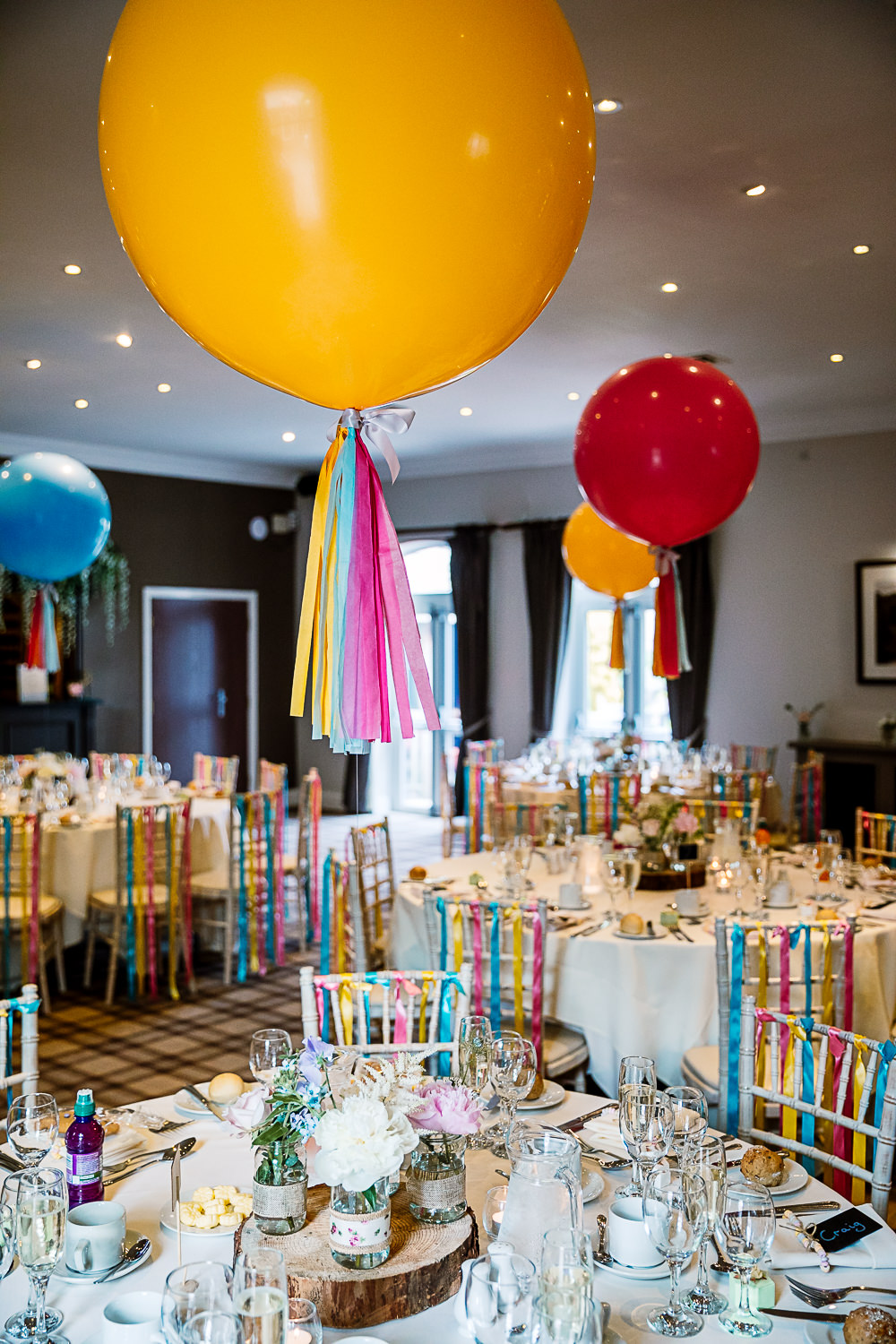 Reception Room Decor Giant Balloons Colourful Tassel Ribbons Coniston Hotel Wedding Hayley Baxter Photography