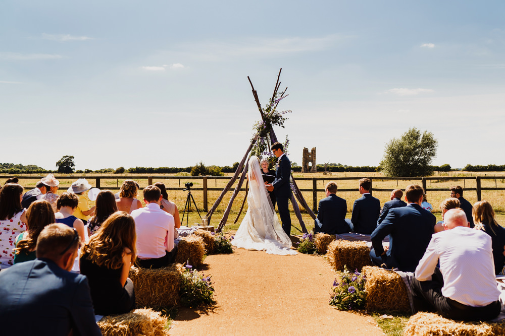 Wooden Triangle Ceremony Aisle Backdrop Flowers Arch Outdoor Hay Bales Godwick Hall Wedding Rob Dodsworth Photography
