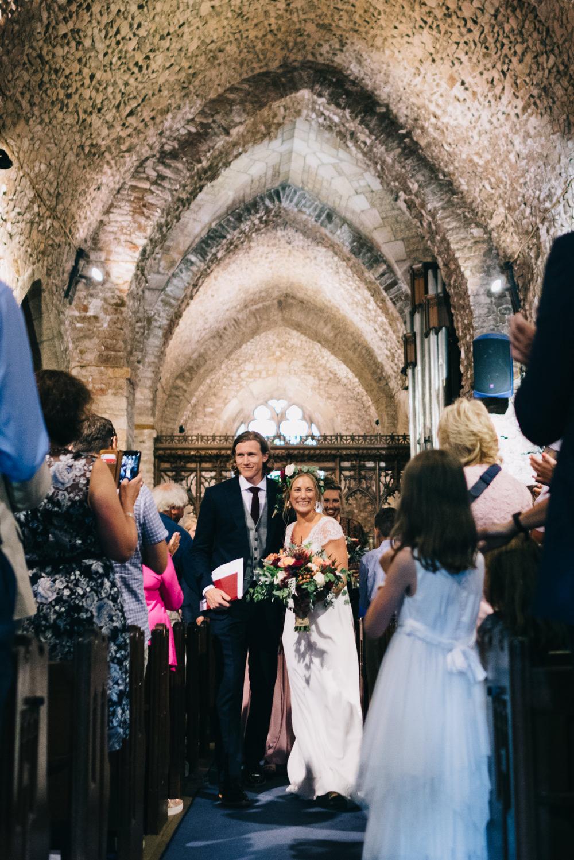 Bride Bridal Laure de Sazagan Dress Lace Cap Sleeve Three Piece Suit Grey Waistcoat Groom Foliage Crown Bouquet Jersey Beach Wedding Peakography