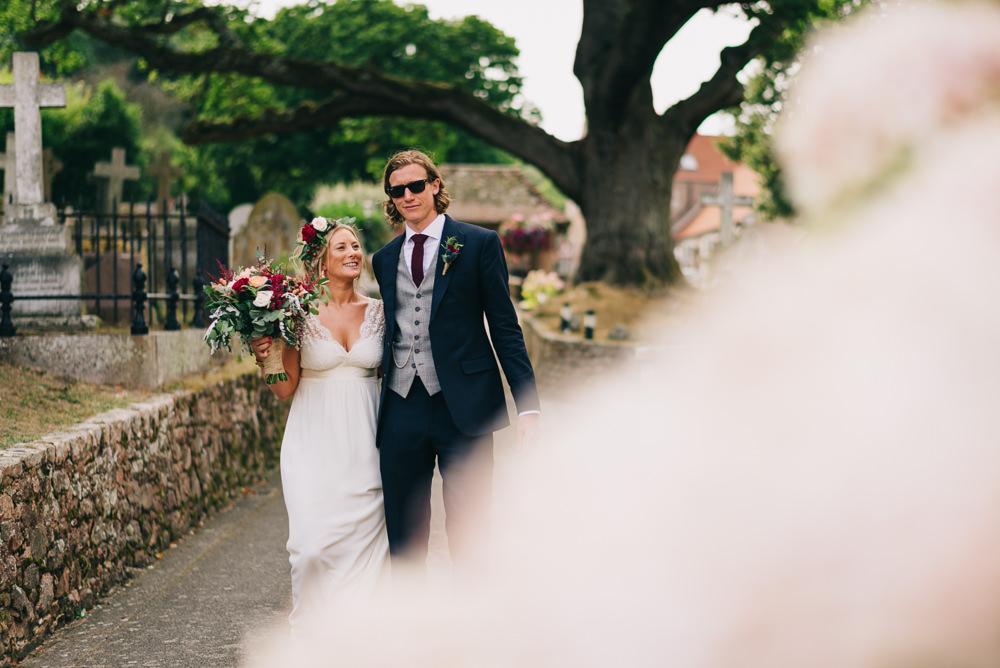 Bride Bridal Laure de Sazagan Dress Lace Cap Sleeve Three Piece Suit Grey Waistcoat Groom Foliage Crown Red Bouquet Jersey Beach Wedding Peakography
