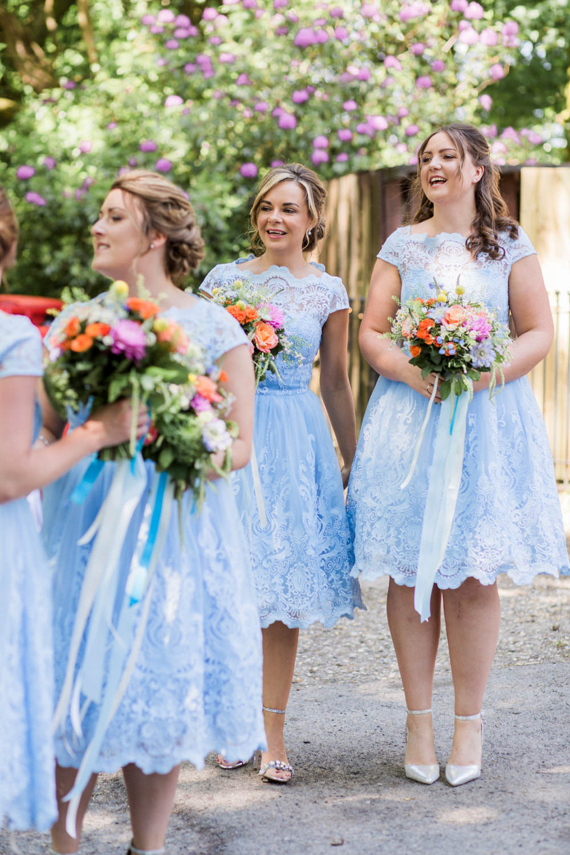 Powder Baby Blue Bridesmaids Tea Length Dress Lace Multicoloured Flowers Bouquet Ribbon Spring Cottage Rivington Wedding Emma B Photography
