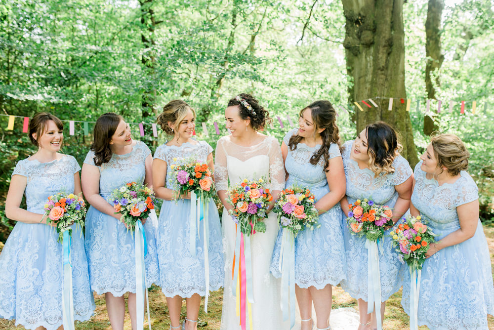 Bride Bridal Strapless Sweetheart Neckline Lace Jacket Sleeves Powder Baby Blue Bridesmaids Tea Length Lace Dress Multicoloured Bouquet Ribbon Spring Cottage Rivington Wedding Emma B Photography