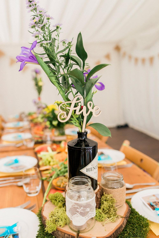 Table Centre Wood Laser Cut Number Gin Bottle Flowers Floral Spring Cottage Rivington Wedding Emma B Photography