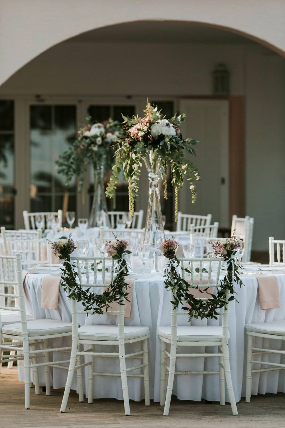 Swag Garland Greenery Foliage Chair Backs Decor Bohemian Beach Greece Destination Wedding Lighthouse Photography