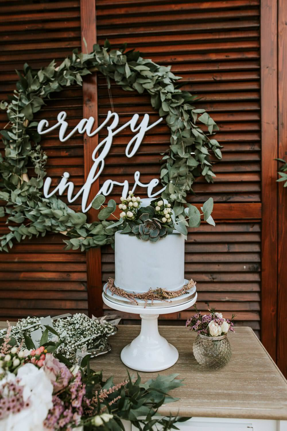 Cake Sign Laser Cut Table Botanical Greenery Foliage Wreath Hoop Backdrop Flowers Bohemian Beach Greece Destination Wedding Lighthouse Photography