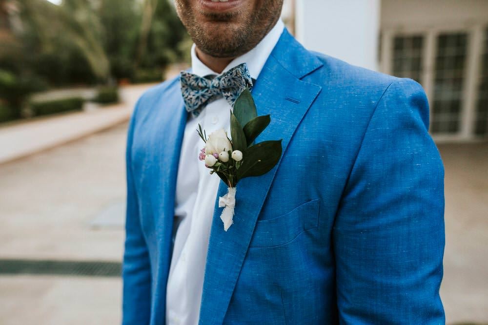 Groom Blue Suit Bow Tie Buttonhole Bohemian Beach Greece Destination Wedding Lighthouse Photography