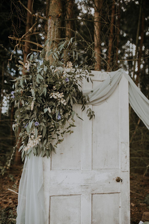 Outdoors Grey Fabric Greenery Foliage Doors Antique Decor Backdrop Bohemian Woodland Wedding Ideas Lola Rose Photography