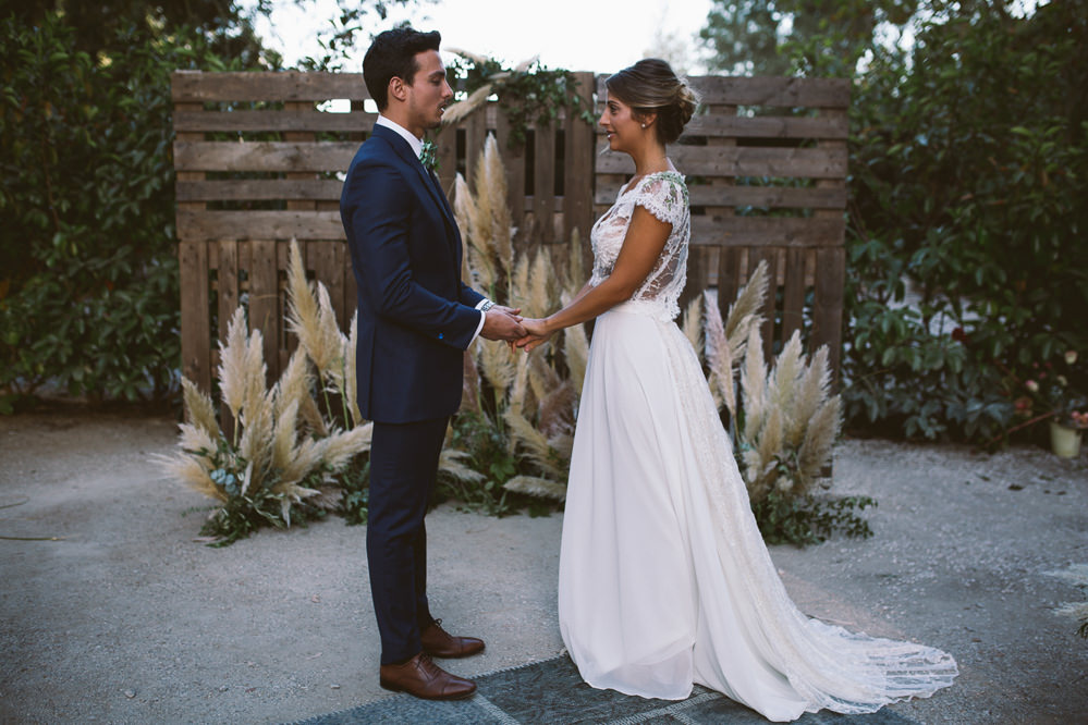 Ceremony Aisle Backdrop Wooden Pallet Crates Flowers Botanical Dark Green Velvet Pampas Grass Wedding Ideas Bárbara Araújo Photography