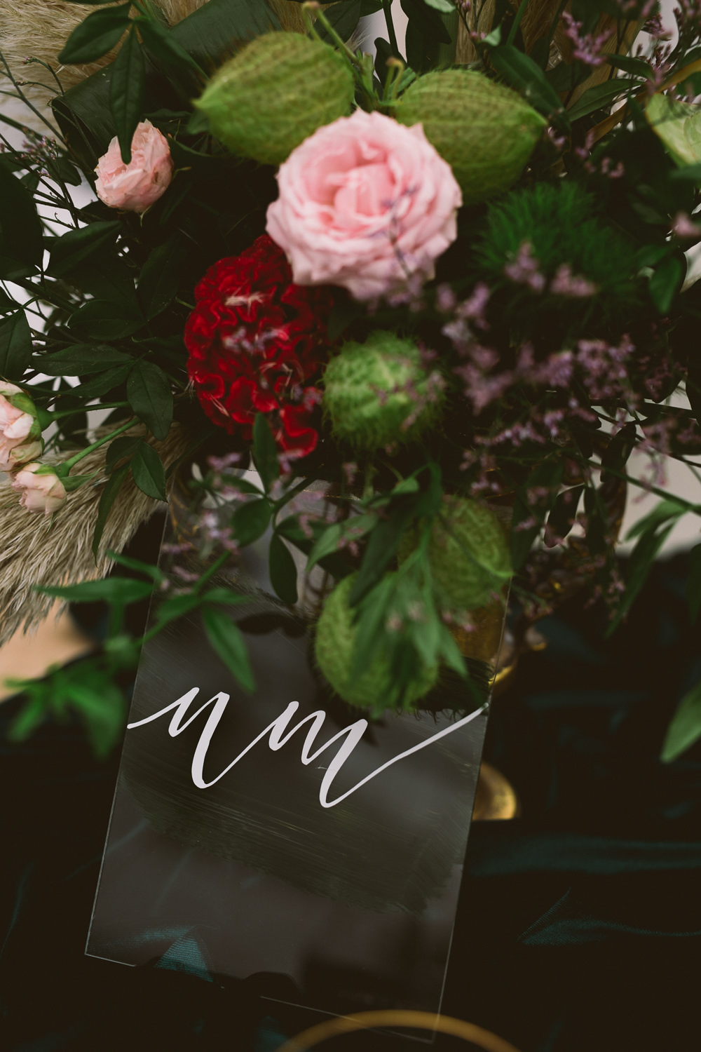 Table Flowers Centrepiece Pink Red Rose Greenery Foliage Perspex Acrylic Table Number Sign Botanical Dark Green Velvet Pampas Grass Wedding Ideas Bárbara Araújo Photography