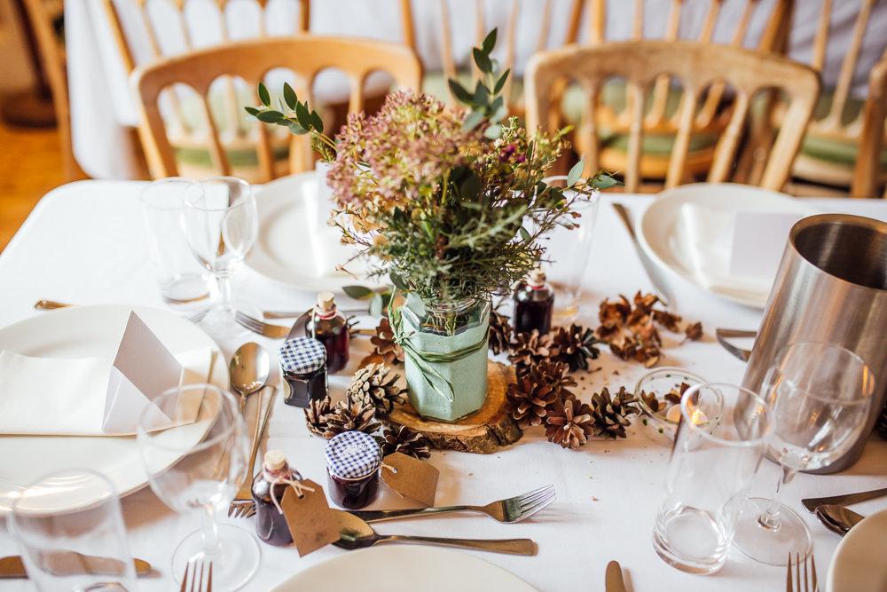 Table Centrepiece Flowers Jar Log Slice Pinecones Decor Druidstone Wedding Florence Fox Photography