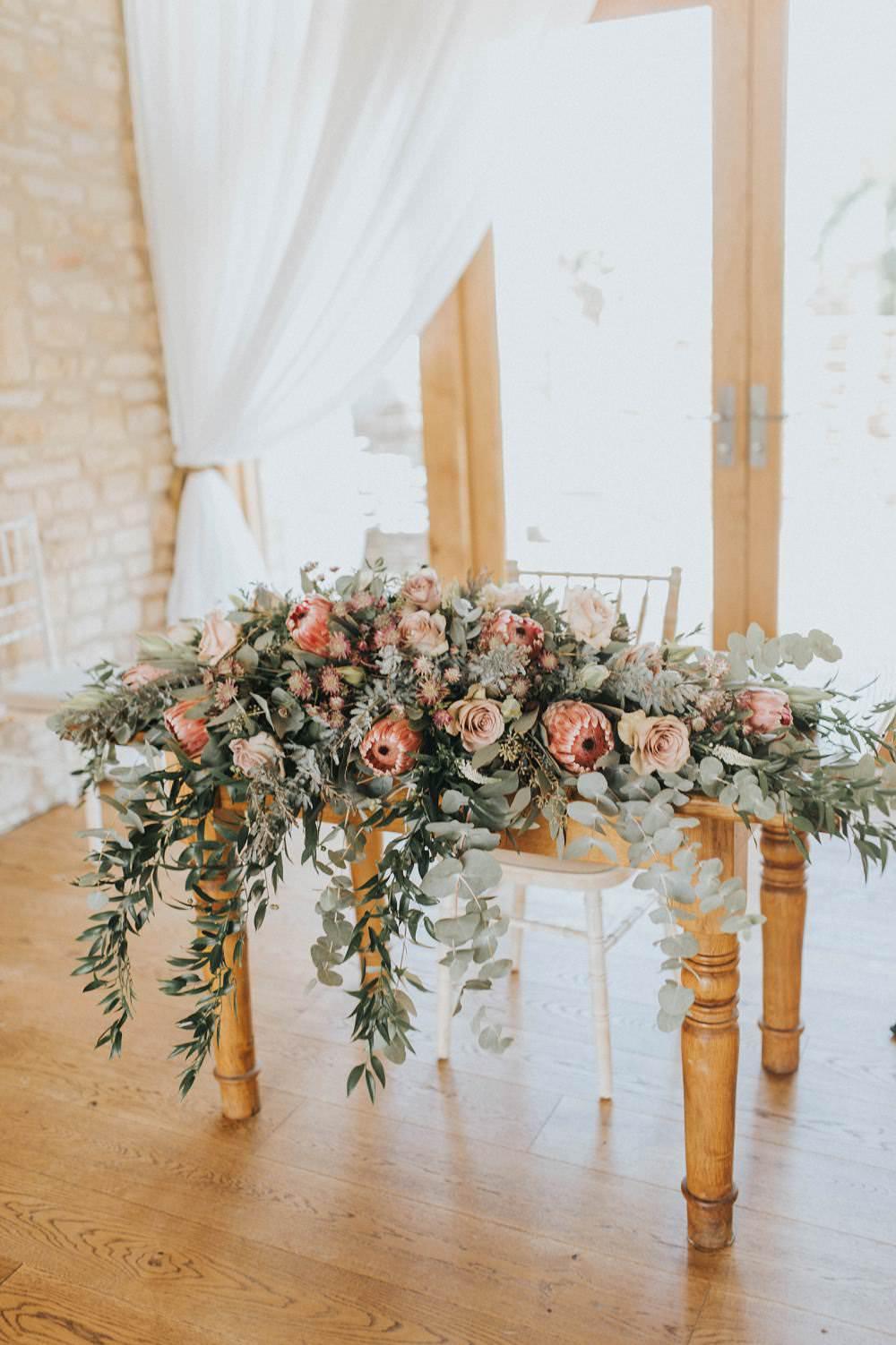 Ceremony Table Flowers Foliage Rose Protea Pink Wild Eucalyptus Boho Greenery Barn Wedding Kerry Diamond Photography