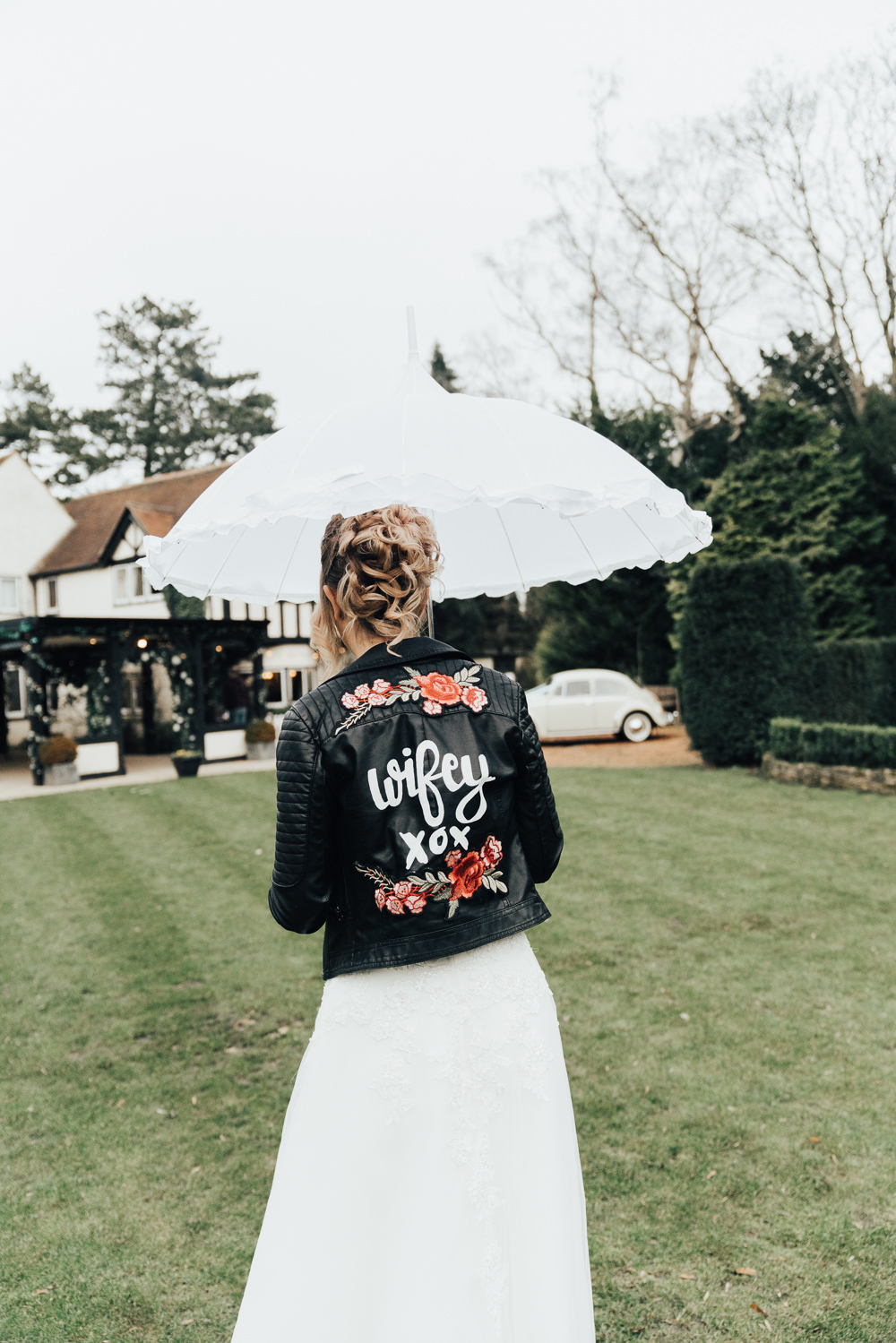 Bride Bridal Jacket Leather Floral Painted Personalised Accessory Hoop Wedding Ideas Rebecca Carpenter Photography
