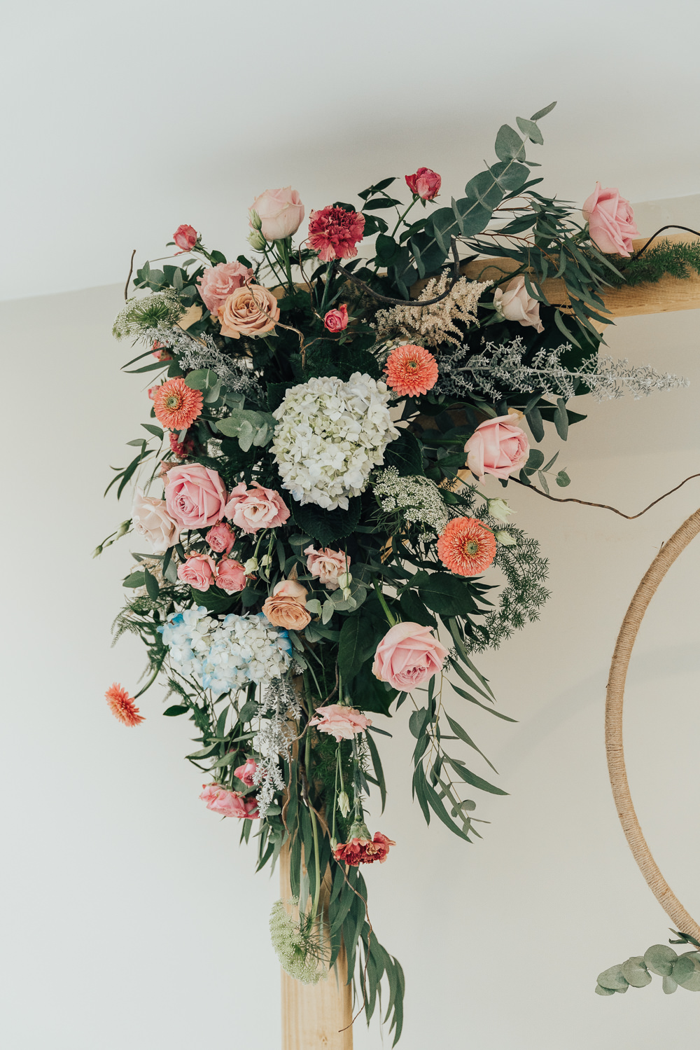 Flowers Floral Arch Backdrop Greenery Foliage Orange Pink Hoop Wedding Ideas Rebecca Carpenter Photography