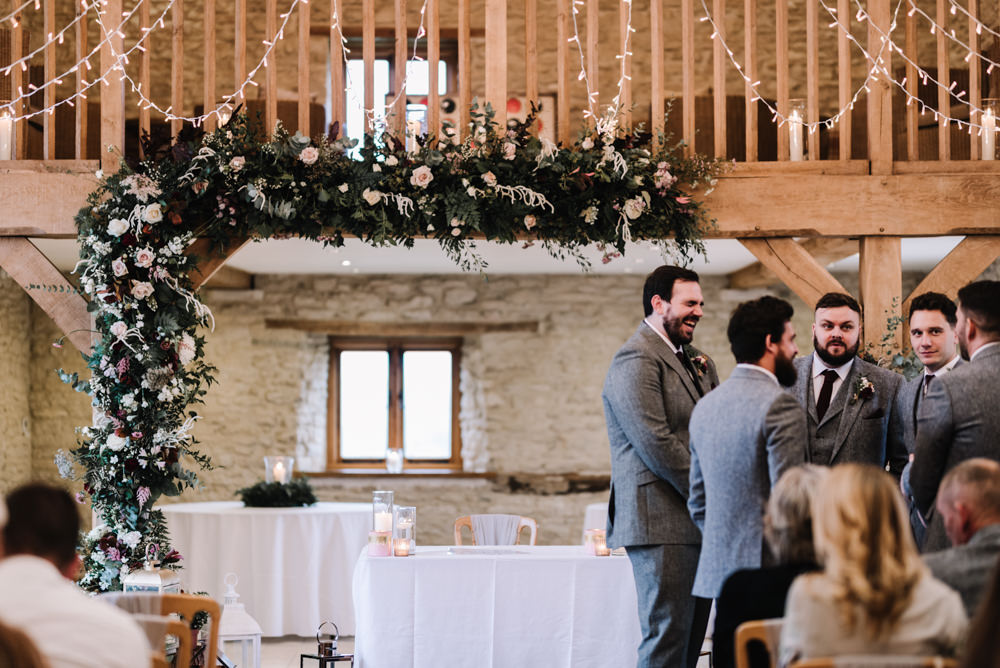 Flower Floral Arch Backdrop Ceremony Aisle Lanterns Greenery Foliage Candles Fern Pink Red Kingscote Barn Wedding Oobaloos Photography