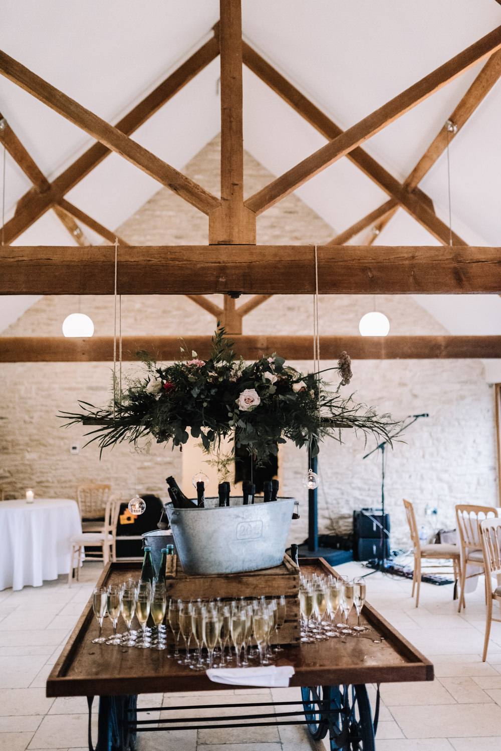 Suspended Hanging Chandelier Flower Floral Decor Greenery Foliage Pink Red Kingscote Barn Wedding Oobaloos Photography