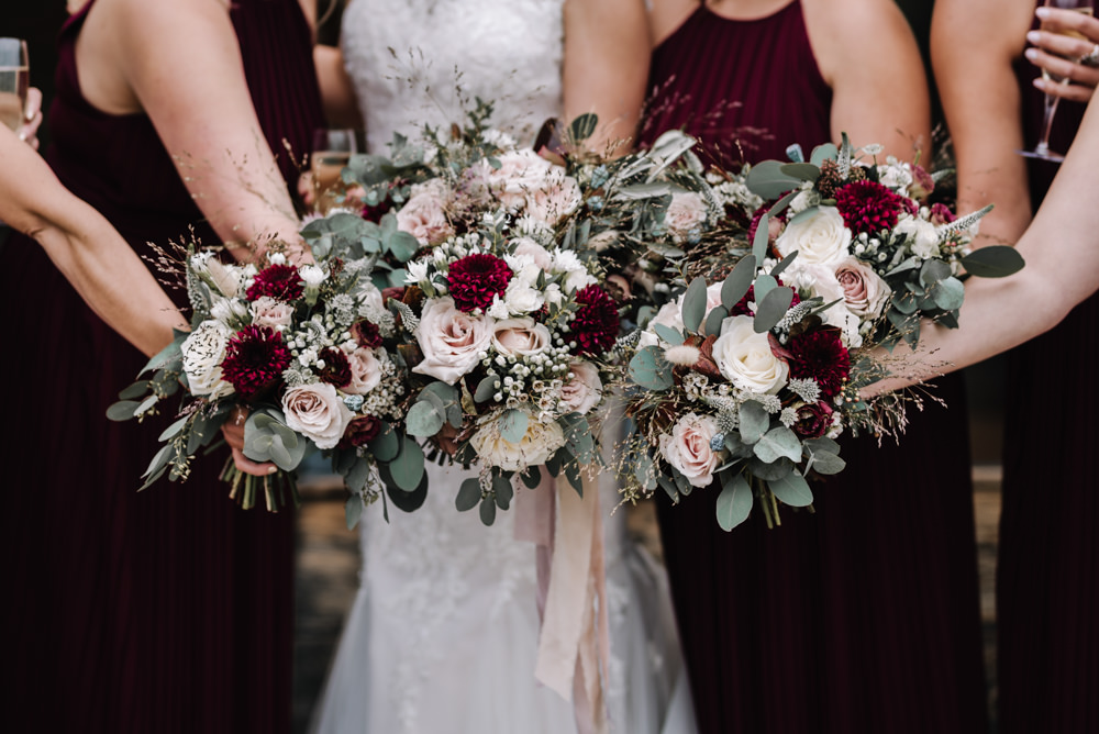 Bouquet Flowers Red Pink Burgundy Bride Bridal Rose Greenery Foliage Ribbons Dahlia Eucalyptus Bridesmaids Kingscote Barn Wedding Oobaloos Photography
