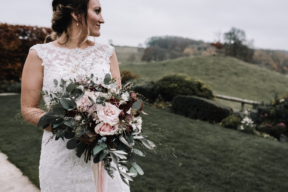 Bouquet Flowers Red Pink Burgundy Bride Bridal Rose Greenery Foliage Ribbons Dahlia Eucalyptus Kingscote Barn Wedding Oobaloos Photography