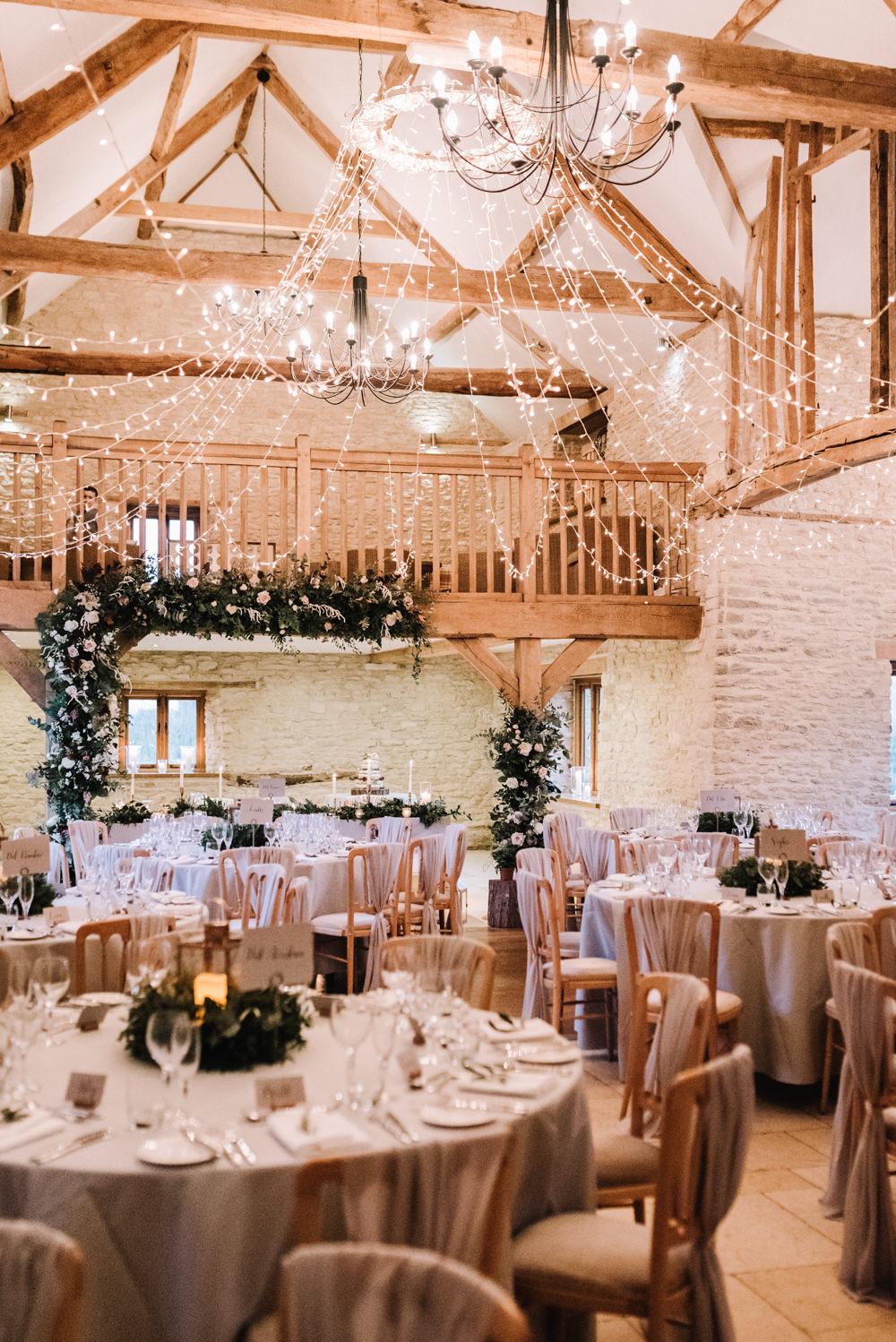 Flower Floral Arch Backdrop Decor Lanterns Greenery Foliage Candles Fern Pink Red Fairy Lights Kingscote Barn Wedding Oobaloos Photography