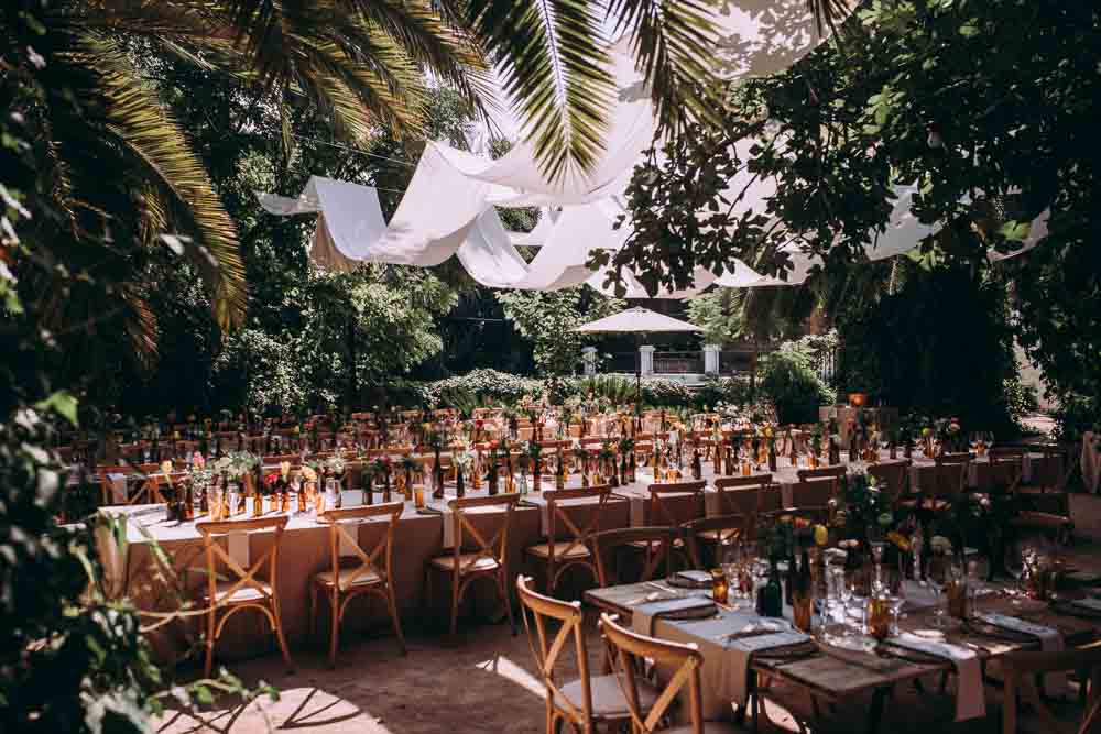 Reception Decor Long Wooden Tables Fabric Drapes Ceiling Botanical Gardens Outdoor Mountain Wedding Spain Lorena Erre