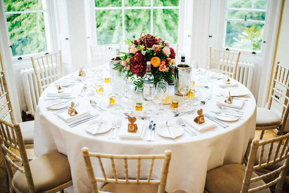 Centrepiece Table Flowers Burgundy Hydrangea Orange Daliah Rose Greenery Foliage Pembroke Lodge Wedding Mark O'Brien Photography
