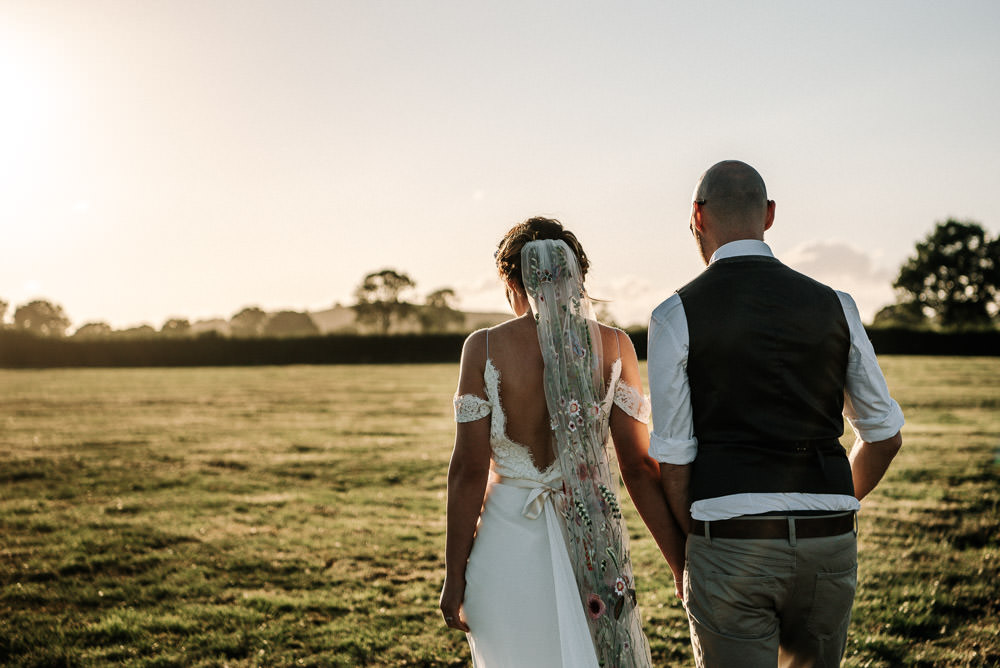 Bride Bridal Dress Gown Lace Detail Drop Cold Shoulder Ribbon Bow Sleeveless Waistcoat Groom Floral Veil Stanford Farm Wedding Andy Griffiths Photography