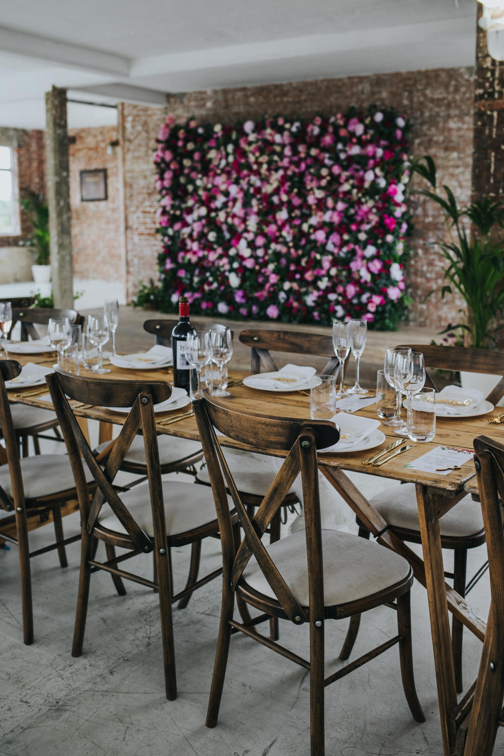 Long Wooden Rustic Table Chairs Pink Flower Wall Backdrop Wimborne House Wedding Eva Photography