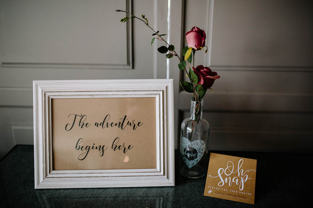 The Adventure Begins Here Sign Frame Rose Bottle Yorkshire Wedding Barn Anna Rose Photography